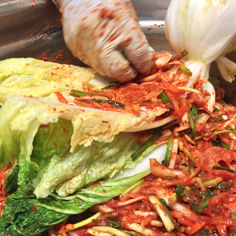 9. Add sauce-stuffing mixture between cabbage leaves.